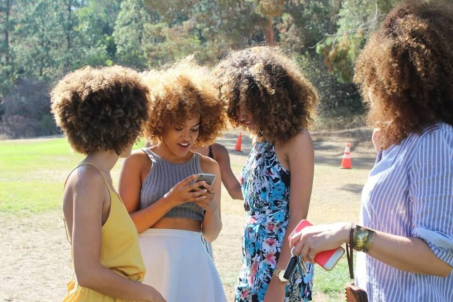 Picture of a group of ladies trying to figure out how to identify iphone model name from model number