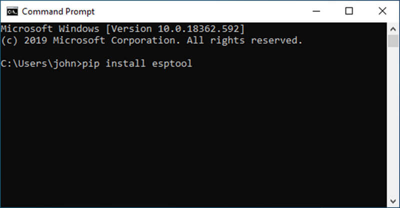 Screenshot of the Windows command prompt showing the command used for installing Esptool on Windows 10